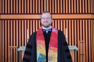 Nathan Willard in robe by altar